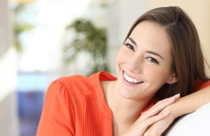 woman smiling on couch