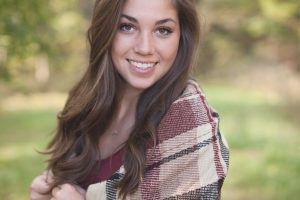 girl with brown hair smiling